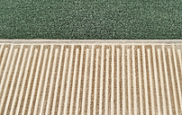 USA, Aerial of a harvested farm field next to a field of corn - BCDF00327