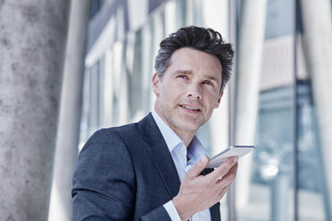 Portrait of businessman using cell phone - RORF00987