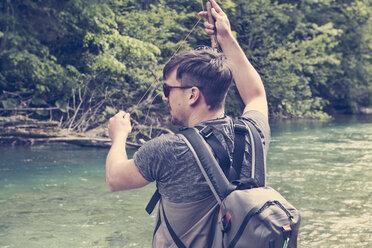Slovenia, man fly fishing in Soca river - BMAF00310