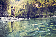 Slovenia, two men fly fishing in Soca river - BMAF00316