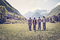 Slovenia, Bovec, four anglers standing on meadow near Soca river - BMAF00337