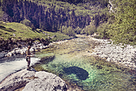 Slovenia, man fly fishing in Soca river - BMAF00343