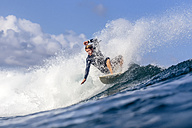 Indonesia, Bali, surfer on a wave - KNTF00878