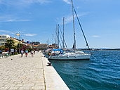 Croatia, Sibenik, Adria coast, waterfront promenade with sailing boats - AM05467