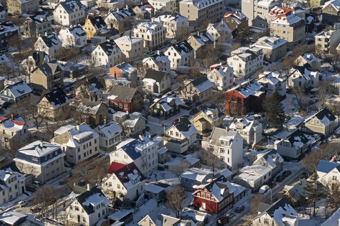 Iceland, Reykjavik, aerial view of residential area with snowcapped house roofs - MELF00185