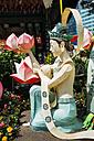 South Korea, Seoul, Woman with lotus lantern at Jogyesa Temple to celebrate Buddha's Birthday - GEMF01755