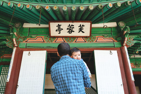 South Korea, Seoul, Father and baby girl visiting the Secret Garden in Changdeokgung Palace - GEMF01761