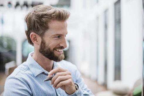 Portrait of smiling businessman - DIGF02735