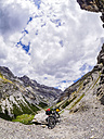 Italy, Lombardy, Sondrio, mountainbike on trail towards Umbrail Pass - LAF01876