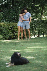 Couple in love with dog in a park - ALBF00151