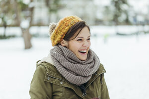 Portrait of laughing woman in the snow - ZEDF00800