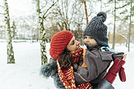 Mother and little son in the snow - ZEDF00806