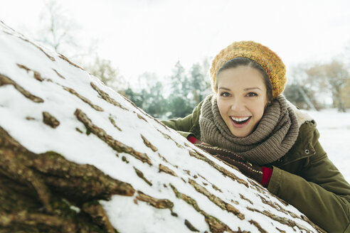 Portrait of laughing woman in the snow - ZEDF00815