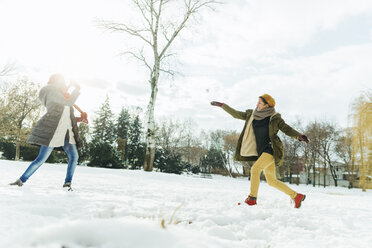 Friends having a snowball fight in the snow - ZEDF00818