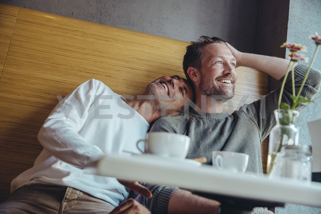 Gay couple enjoying their time together in cafe - MFF03889
