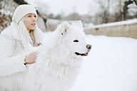 White dog and owner in the snow - ZEDF00832