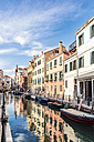 Italy, Venice, alley and boats at canal - CSTF01364