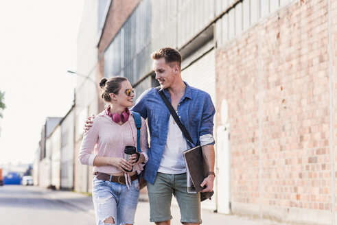 Young couple walking on the street - UUF11526