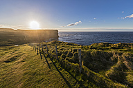 UK, Scotland, Caithness, Coast of Duncansby Head at sunset - FOF09284
