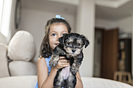 Little girl with her puppy at home - JASF01801