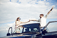 Carefree young couple with car - ABIF00015