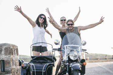 Portrait of three laughing bikers with their sidecar motorcycle - JASF01804
