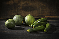 Eight ball squashes and courgettes on dark wood - MAEF12396