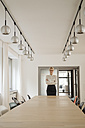 Confident businesswoman standing in conference room - JOSF01519