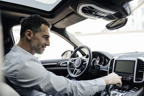 Businessman driving car - KNSF02468