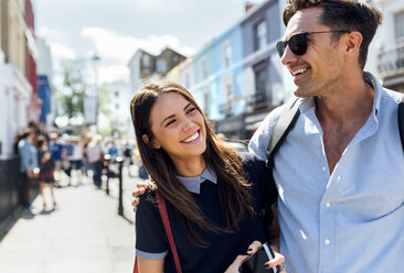 UK, London, Portobello Road, portrait of happy couple - MGOF03580