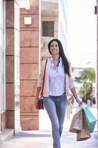 Mature woman on a shopping spree - WESTF23488