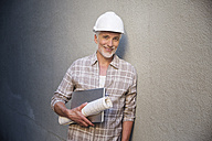 Portrait of a mature man, wearing hard hat - WESTF23563