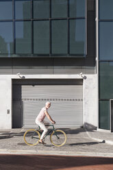 Mature man riding bicycle in the city - WESTF23575
