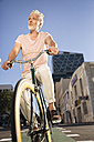 Mature man riding bicycle in the city - WESTF23578
