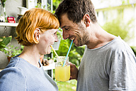 Laughing couple drinking lemonade together - SPFF00009