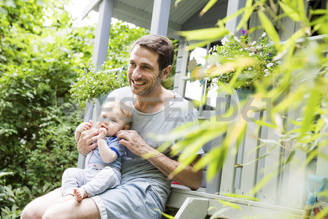 Portrait of mature man with baby son sitting on his lap - SPFF00027