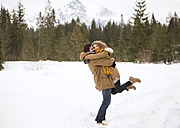 Happy young couple in snow-covered winter landscape - HAPF02037