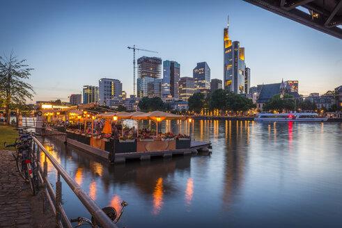 Germany, Frankfurt, view from Schaumainkai to skyline at evening twilight - KEB00602