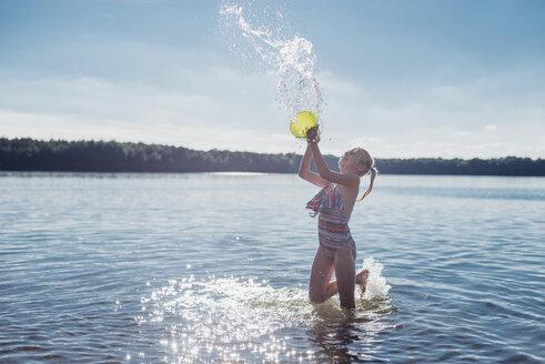 Girl splashing with water at lakeshore - MJF02176
