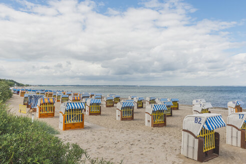 Germany, Timmendorf Beach with hooded beach chairs - KEBF00607