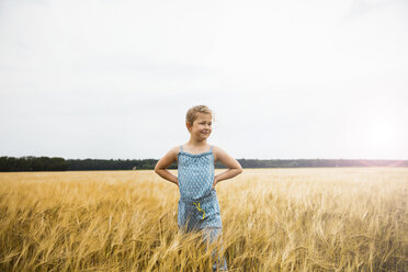 Girl standing in grain field at sunset - MOEF00077