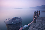 Italy, Piedmont, jetty at Lago Viverone at twilight - SIPF01669