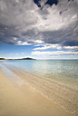 Italy, Sardinia, beach under cloudy sky - SIPF01672