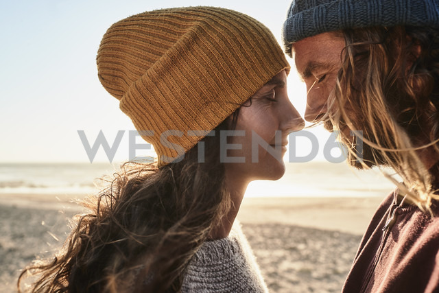 Portugal, Algarve, affectionate couple on the beach at sunset - JRF00335