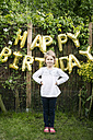 Portrait of girl in the garden with decoration for Birthday Party in the background - MOEF00139