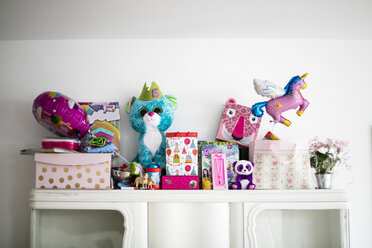 Little girl's birthday presents on a cabinet - MOEF00142