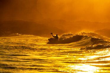 UK, Scotland, East Lothian, Kayak Surfing at sunset - SMAF00819