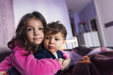 Portrait of little girl embracing her brother - JASF01813