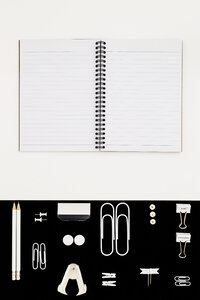 White office utensils on black background and notepad on whilte background - MELF00188