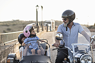 Spain, Jaen, grandfather, grandmother and grandson on motorcycle with a sidecar - JASF01828